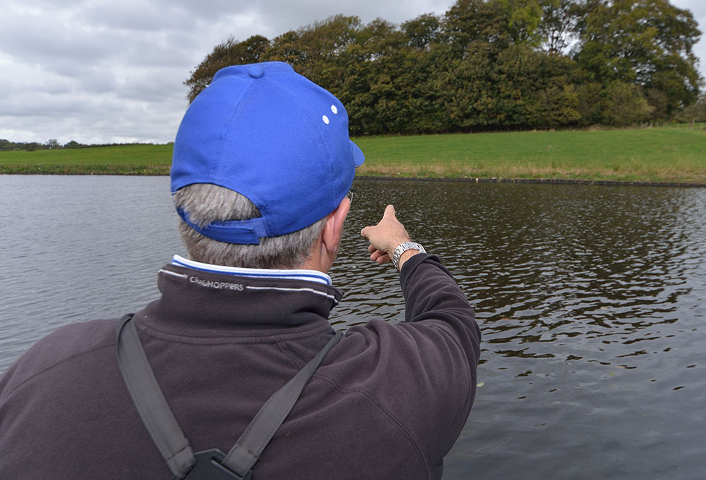 Alan points to his marker which is the white object on the far bank