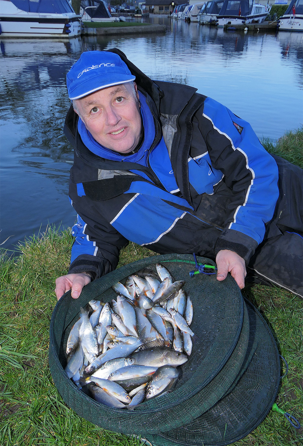Alan with a hard-earned 6lb net of roach, hybrids and perch.